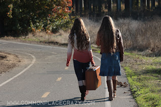 girls walking with suitcase
