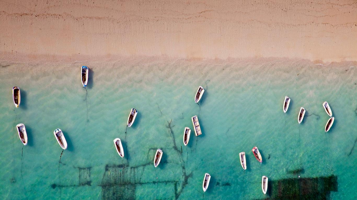 Aerial View Of Rowboats Near Bali Indonesia C Sean White Plainpictures