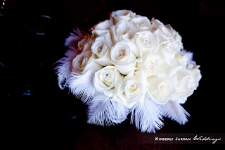 white bridal bouquet with feathers by Cactus Flower