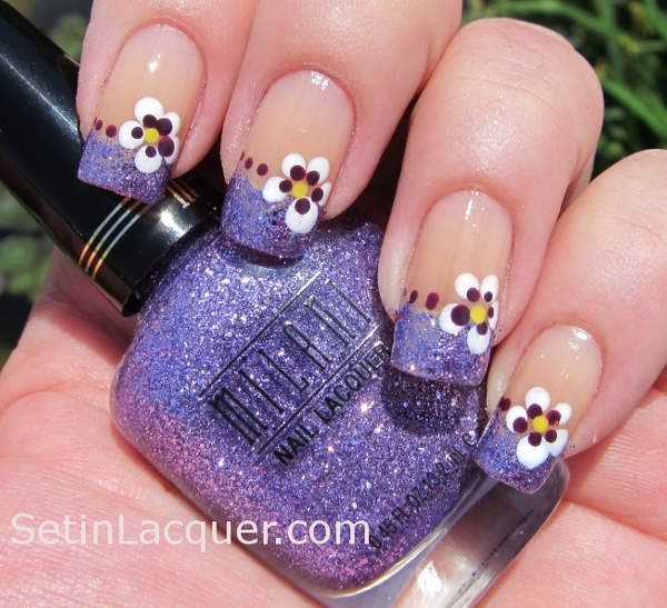 Dotted pansies with glitter tips nail art