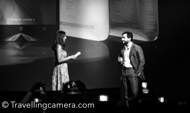 Recently we visited Kingdom of Dreams  and Saif Ali Khan was there for launch of an Android phone. He is there on the stage for 5-7 minutes and throughout he was looking at the huge screen installed on the left side. Live telecast was happening on this screen and he was ensuring that he is looking good. Hair style is fine. The suit he is wearing is looking nice and so on. This Photo Journey shares some photographs from the same event which shows some interesting shots of Saif Ali Khan :). This was the time when media was clicking him with Asus Zenfone2 in different poses and he was continuously looking the screen above to ensure that things are looking good. I wish there was a screen on front as well :) . That would have been convenient for Saif. Even when he was discussing about the phone and technology on the stage, his eyes were continuously on the screen. The photograph below is very interesting, where everyone else is looking at the media cameras except Mr Saif Ali Khan.