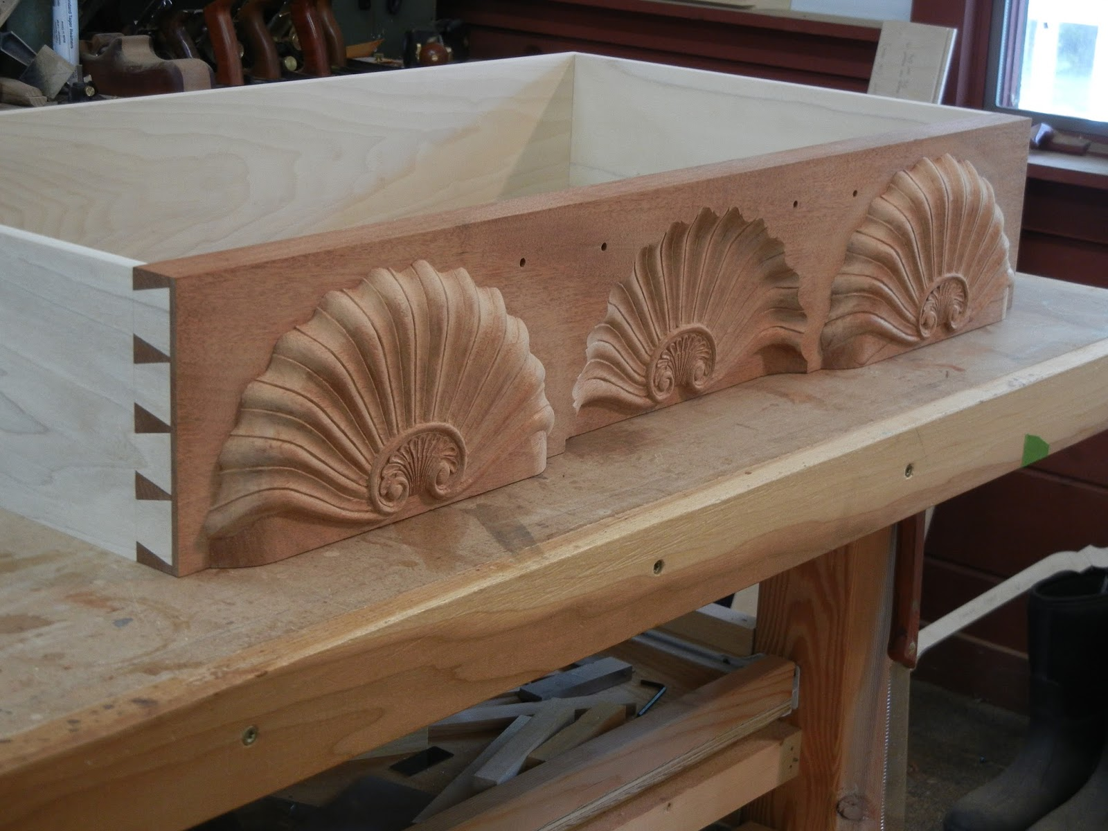 hand carved shells and dovetails