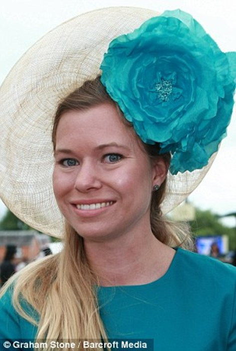 lovely lady in a straw disc hat accessorised with a huge turquoise peony on day 2 at Royal Ascot, 2014
