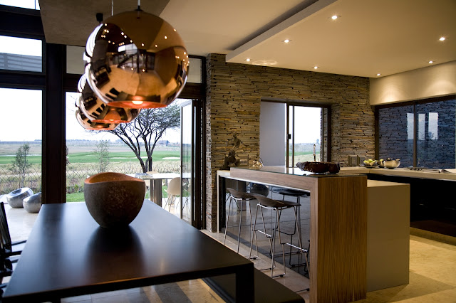 Modern kitchen and dining room of Serengeti House by Nico van der Meulen Architects