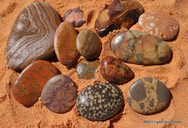 Unique sea stones on Sahara sand