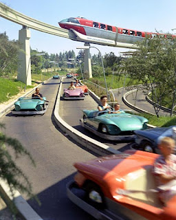 The monorail zooms over a classic Autopia