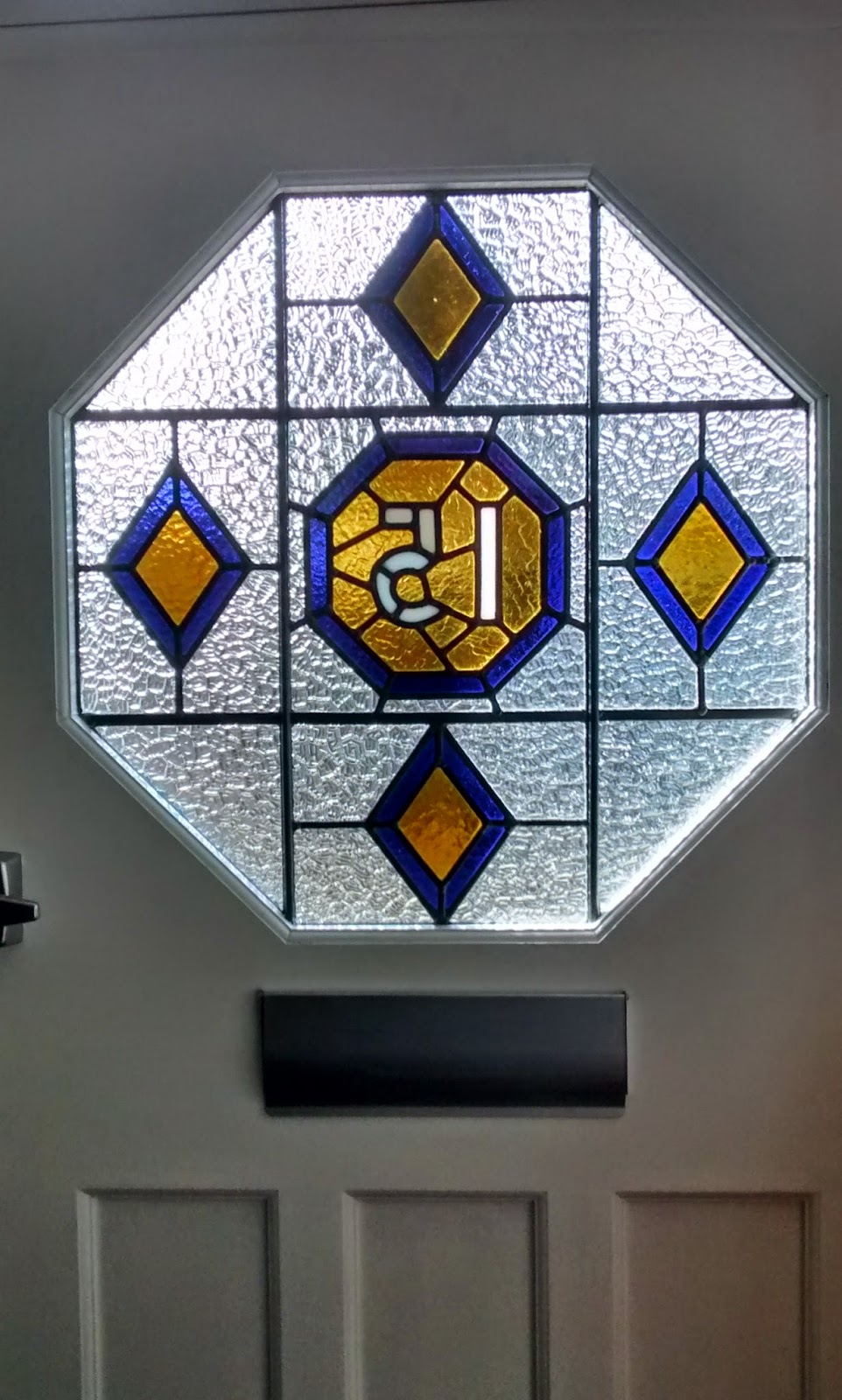 Stained glass for london and south east unusual octagonal door panel with number the client had a replacement door made to the original pattern we remove the stained glass from the old door eventelaan Gallery