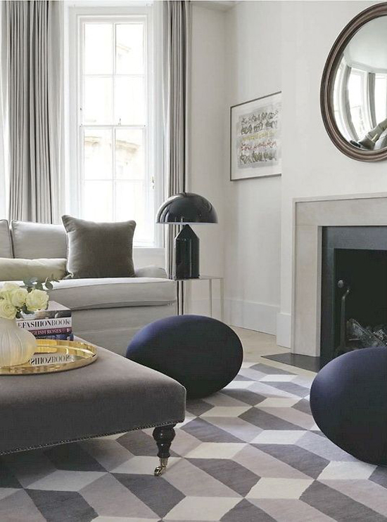 Contemporary sophisticated forms and hues by the fireplace.