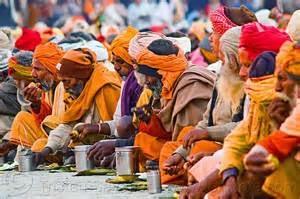 hindu pilgrims eating holy prasad - kumbh mela 2013
