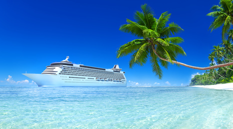 Cruise Ship in Tropical Waters with Beach