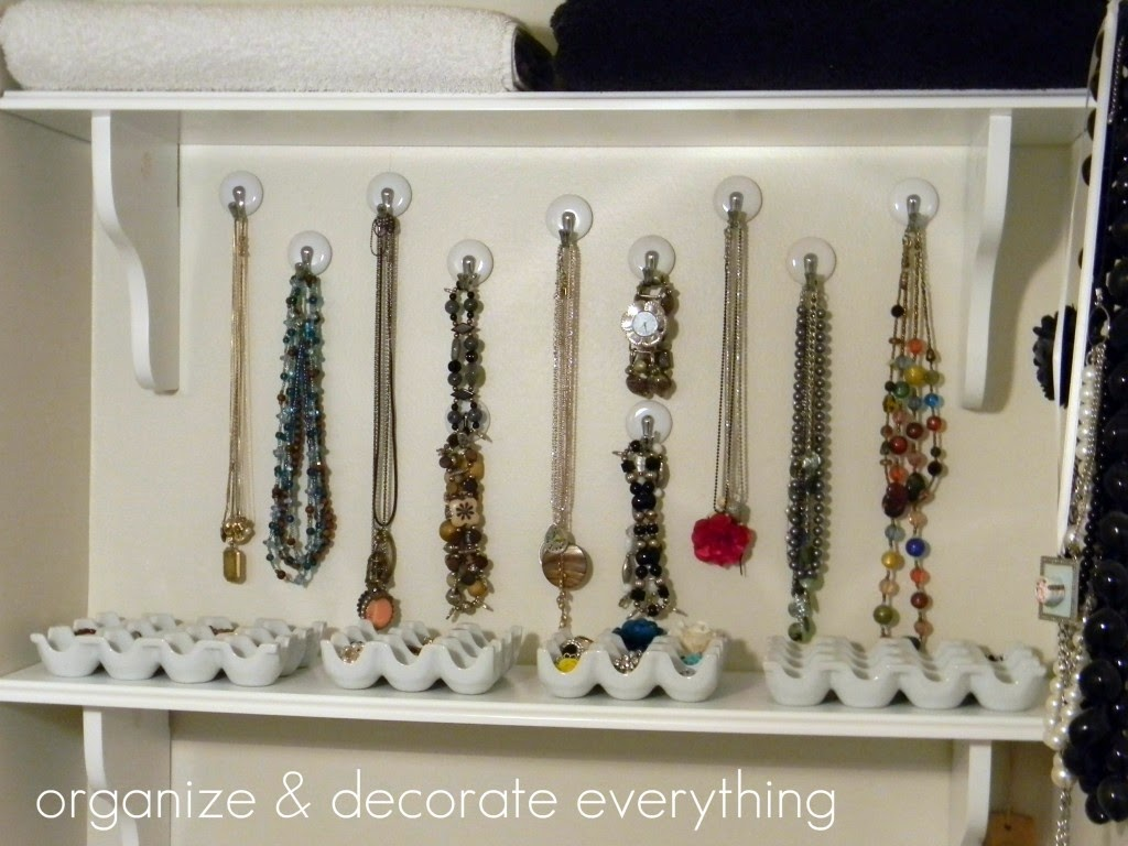 Jewelry organized in linen closet :: OrganizingMadeFun.com