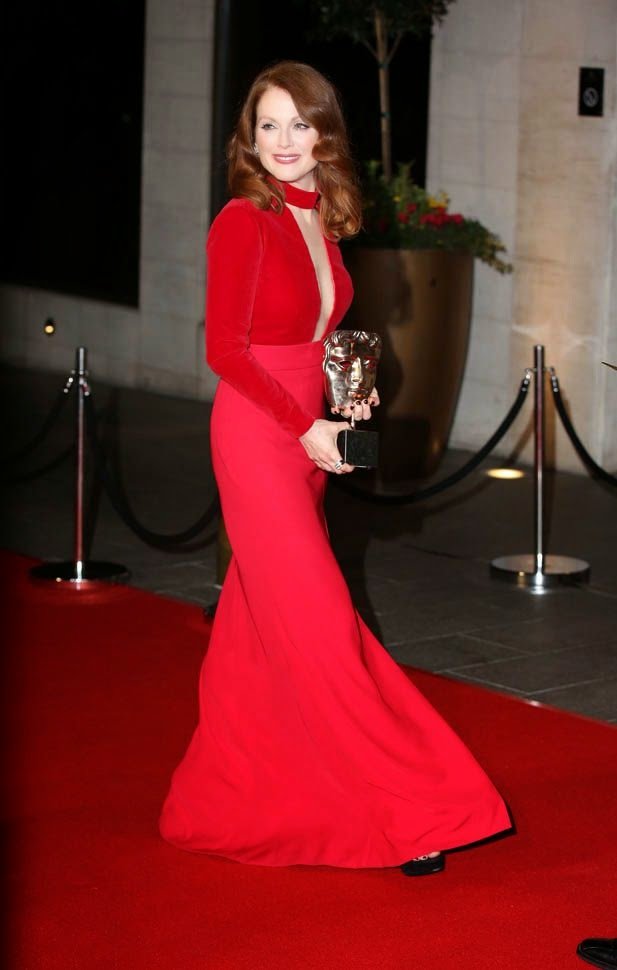 A wonderful honour have been obtained into her holly hand during a red carpet steps to the EE British Academy Film Awards (BAFTA) at London on Sunday, February 8, 2015.