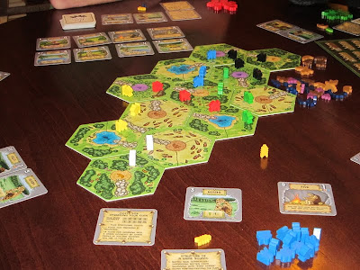 Power Grid: The First Sparks - The game board and clansmen