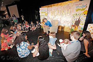 Winnie the Pooh Storyteller of Year winner Steven Prusakowski from New Jersey reads Winnie the Pooh and Blustery Day to the kids at PLUSH 2013.