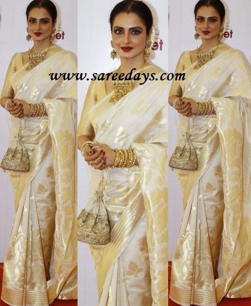 Latest saree designs rekha in off white traditional silk saree checkout rekha in off white traditional silk saree with zari work and zari border and paired with matching half sleeves blouse altavistaventures Images