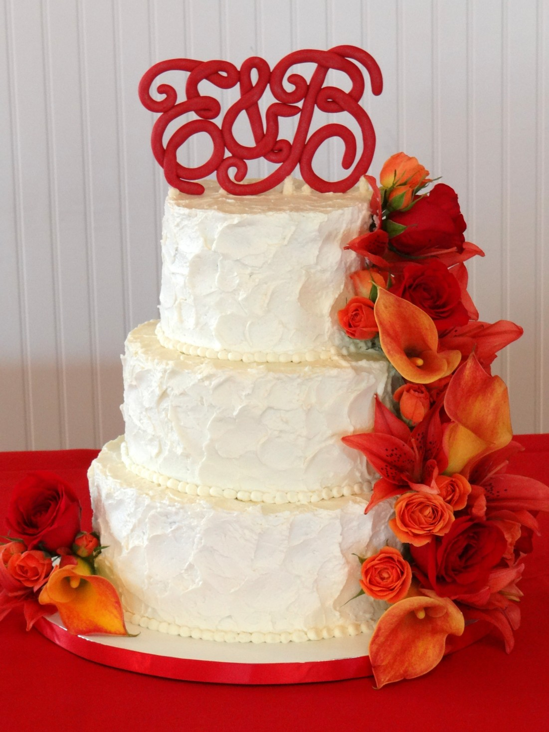 Tiers of Joy Cakery Textured Wedding Cake with Red