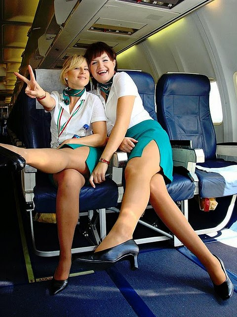 image Asian stewardesses take new members for the mile high club