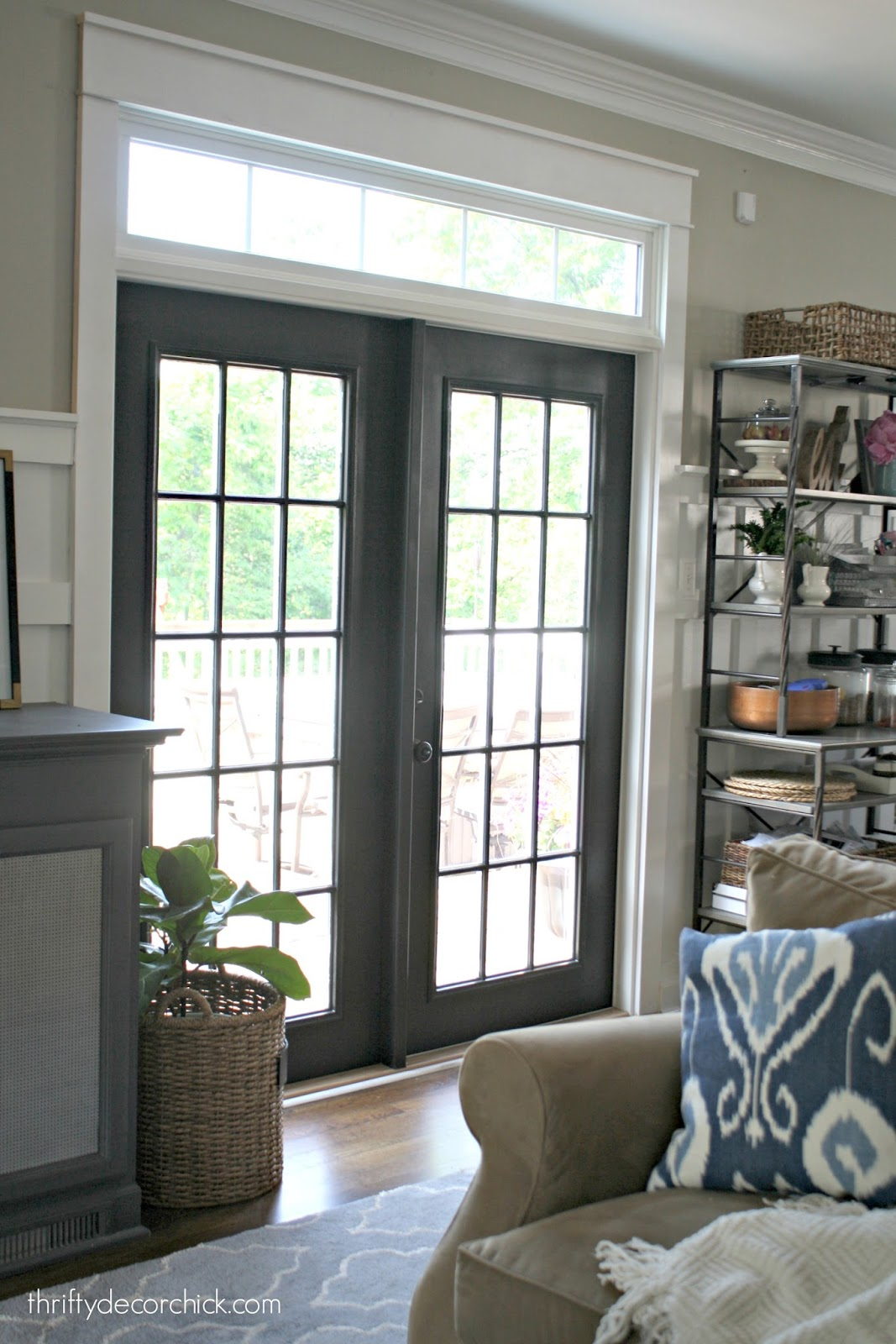The curse of the back door from thrifty decor chick for Black sliding glass doors