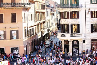 a beautiful view of the Piazza di Spagna with hundreds of tourist from the Spanish Steps