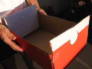 Nan holding a pin-hole projector for the May 20, 2012 annular eclipse
