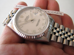 HOLD ROLEX OYSTER PERPETUAL DATEJUST WHITE ROMAN DIAL - ROLEX 16234
