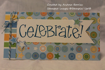 "Birthday card with bright blue, green and orange circles, stars and stripes and a banner that says ""celebrate."""