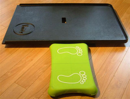 Wii Fit board with Vivify wheelchair ramp.