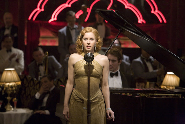 amy adams in miss pettigrew lives for a day 1940s gold gown