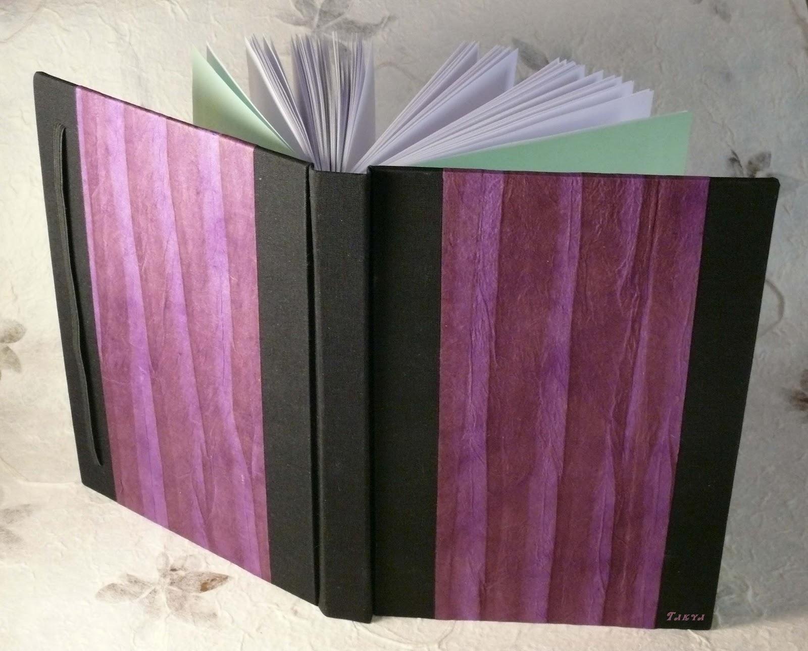 Quaderno nero e viola Quad+2012+2_D_firma