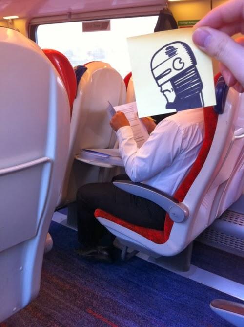 18-Robocop-October-Jones-Bored-on-the-Train-Designs-www-designstack-co