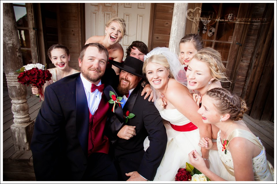 Bridal party gets the groom to laugh.