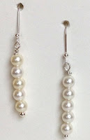 White Swarovski pearl earrings