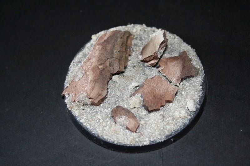 Pegado de la arena en la peana