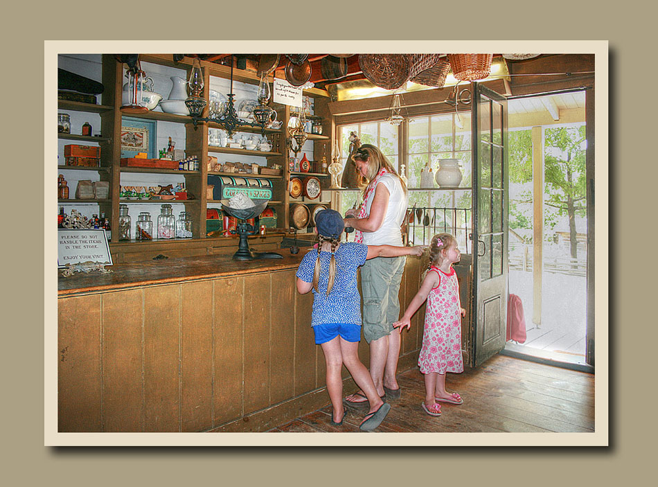 Visitors inspecting the merchandise at Laskay Emporium at Black Creek Pioneer Village.  Holly Cawfield Photography