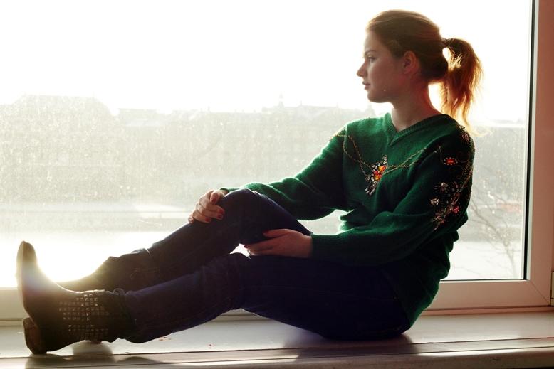 caroline leonhard, sitting on a window, sunlight, sunlight view copenhagen, pixrl romantic filter karen,