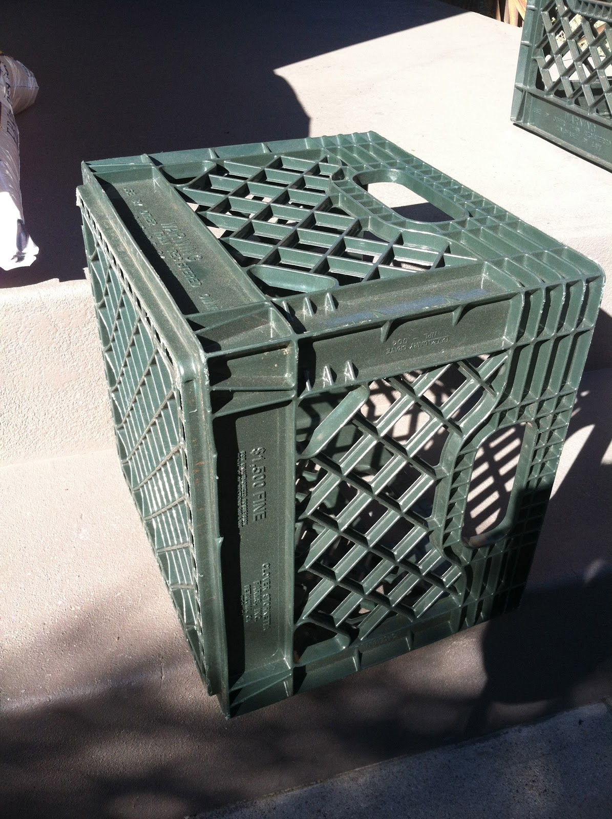 Diy pouf ottoman - Then Cut The Throw Rugs Into Squares A Few Inches Larger Than The Milk Crate