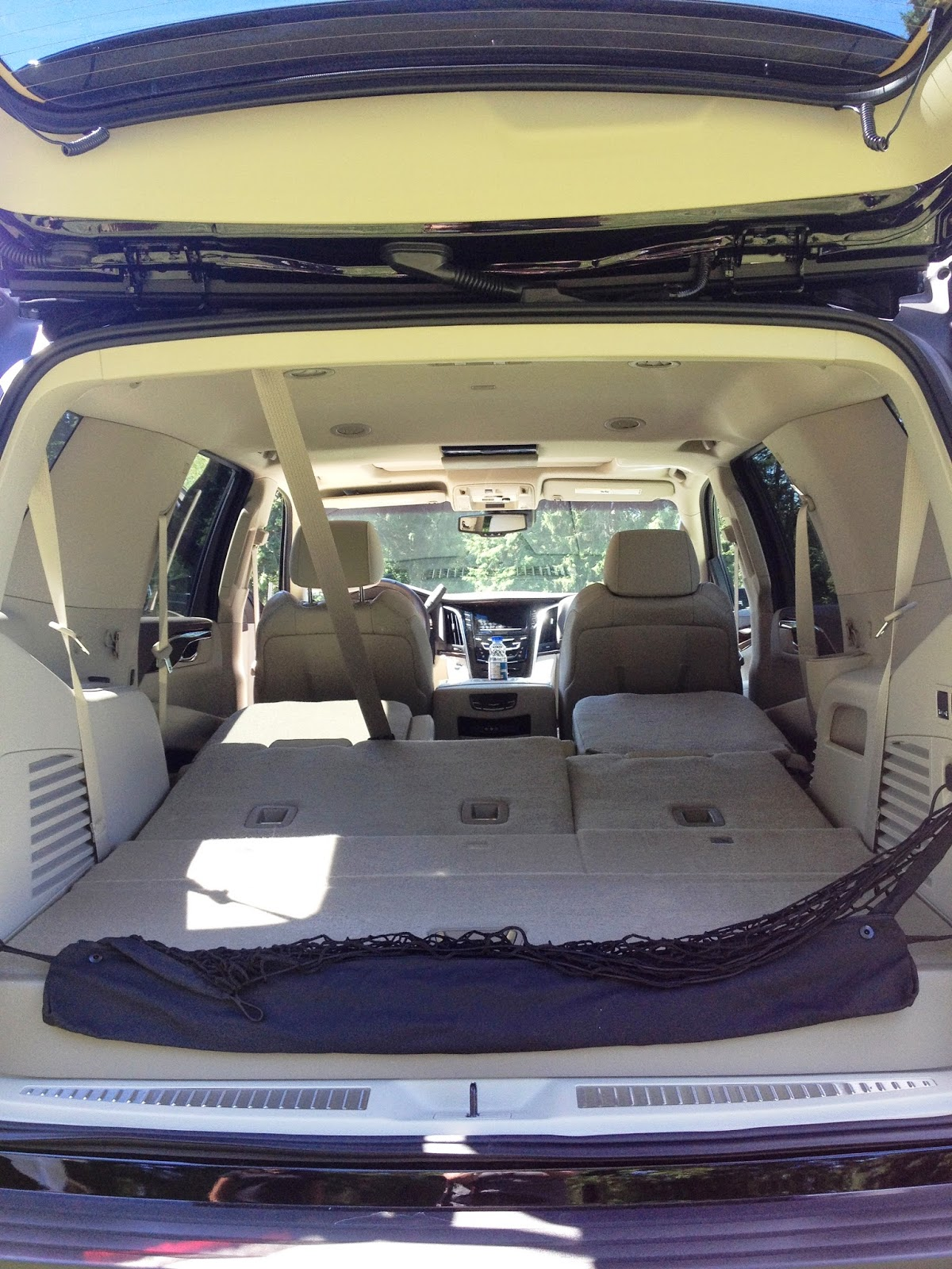 Folded flat second and third row seating of the 2015 Cadillac Escalade