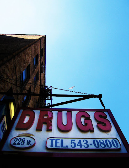 A really big DRUGS sign hanging in Bronx, New York.