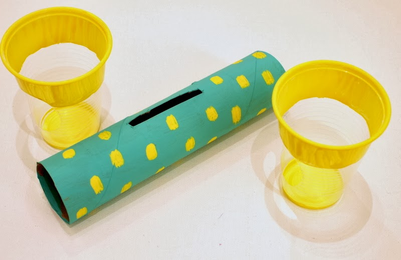 paint the cardboard roll and cups