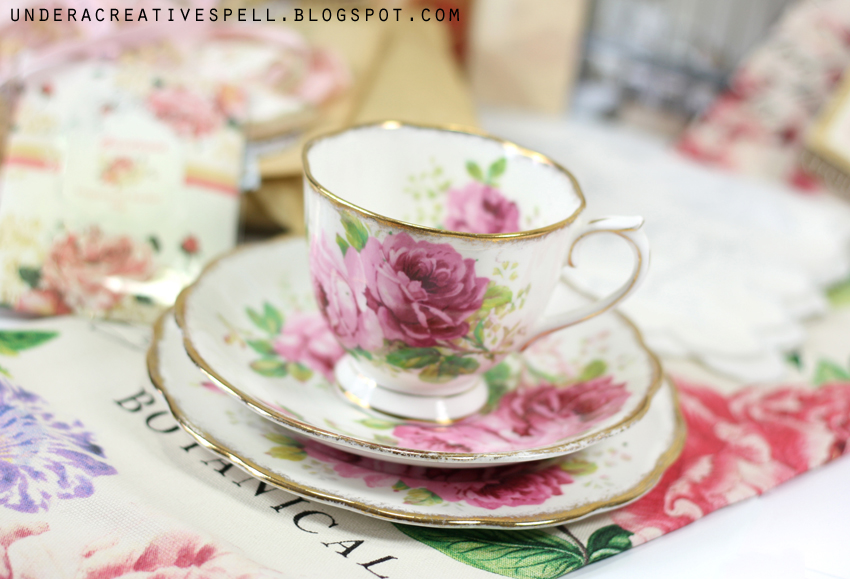Shabby vintage tea cup with pink roses