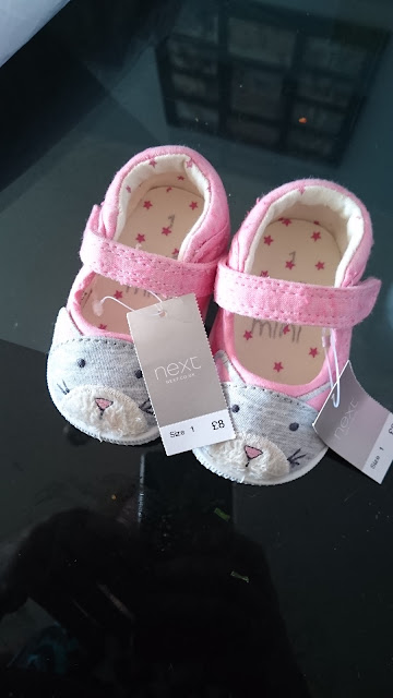 http://www.next.co.uk/girls/newborn-girls/newborn-girls-my-first-wardrobe/9