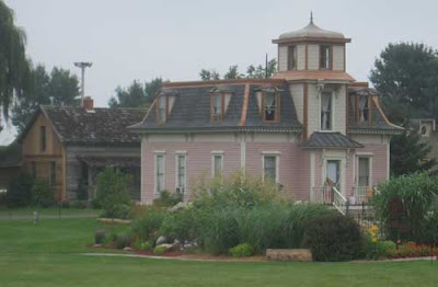 Pink italianate mansard-roofed Victorian house