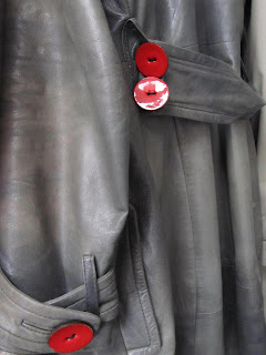 grey coat with red buttons