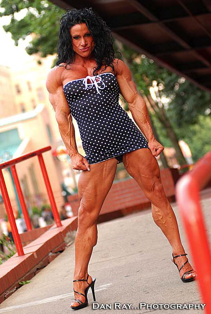 Debbie Bramwell Modeling Her Shredded Physique In A Tiny Dress And Heels