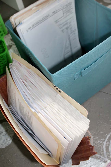 tax documents stored in dollar bin case container