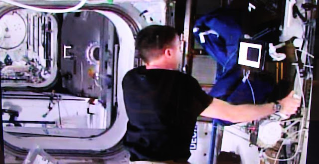 Astronaut Terry Virts on the ISS shaking with the head of ESA's Telerobotics Lab Andre Schiele on the ground via a force-feedback joystick on the evening of 3 June 2015. First the ISS joystick was moved, then the slaved joystick on the ground. Then Andre shook the ground joystick in turn, felt by Terry in orbit. This first 'handshake with space' took place as part of the Lab's Haptics-2 experiment, harnessing advanced telerobotics technology for the control of space robot systems. ESA's Telerobotics and Haptics Laboratory is based at ESA's ESTEC technical centre in Noordwijk, the Netherlands. Credit: ESA–J. Harrod CC BY SA IGO 3.0