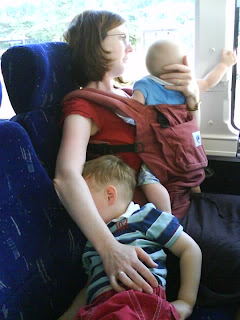 Baby-wearing on a bus with an Ergo and a toddler