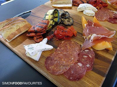 Antipasto platter of sliced cold cut meats, grilled vegetables, cheese ...