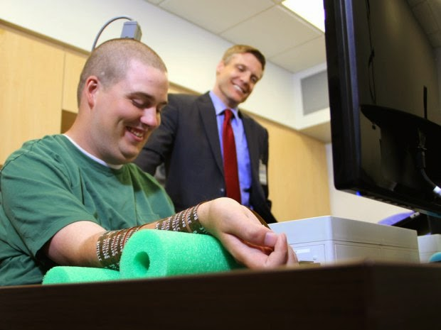 Science fiction come true: Paralyzed man moves arm with his thoughts using microchip in his brain