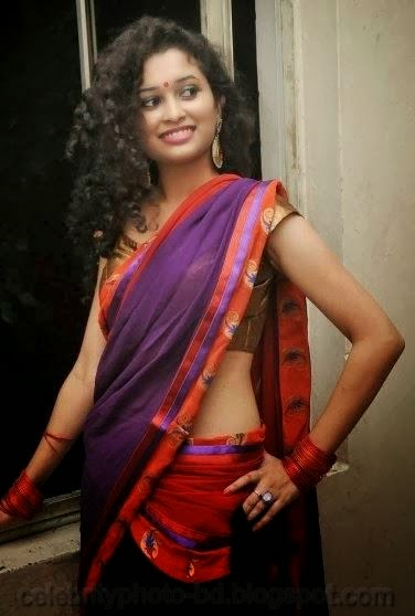 latest+Photo shoot+of+Manochitra+with+a+Hot+Pink+Sari001
